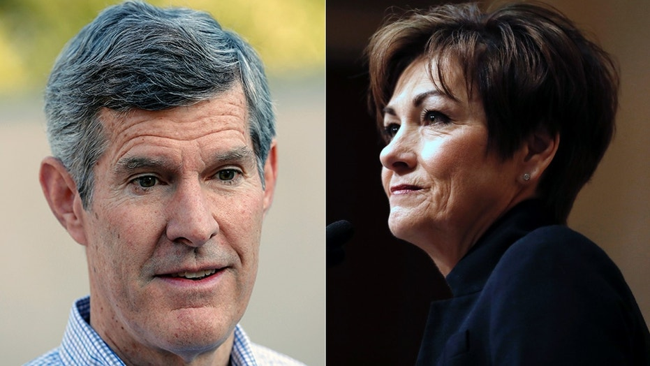 Fred Hubbell, left, and Iowa Gov. Kim Reynolds.