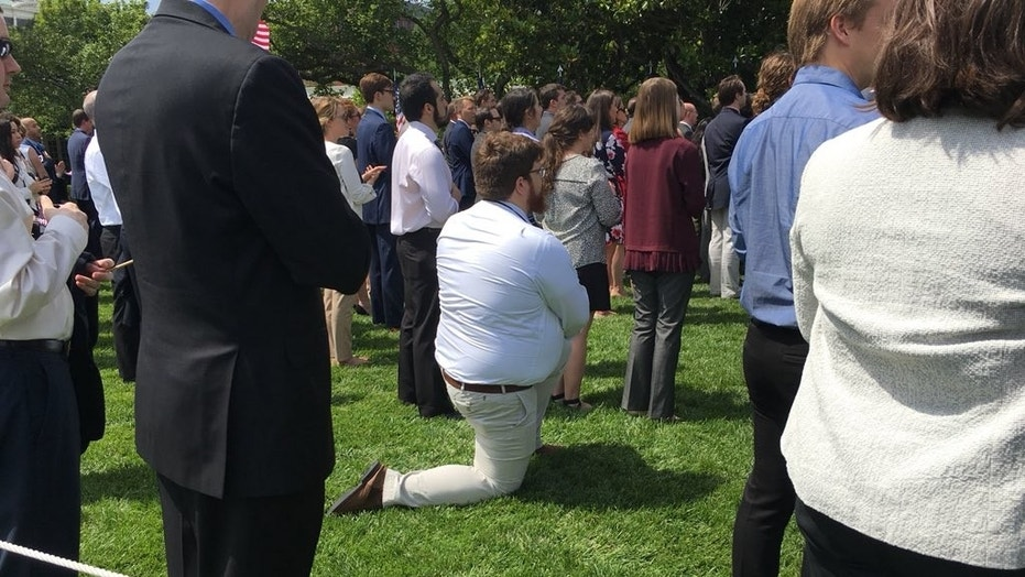 A guest at President Donald Trump's White House event on Tuesday apparently took a knee during the national anthem