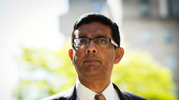 Conservative commentator and best-selling author, Dinesh D'Souza exits the Manhattan Federal Courthouse after pleading guilty in New York, May 20, 2014. D'Souza pleaded guilty to one criminal count of making illegal contributions in the names of others. A second count concerning the making of false statements is expected to be dismissed once the defendant is sentenced. REUTERS/Lucas Jackson (UNITED STATES - Tags: CRIME LAW BUSINESS) - RTR3Q10M