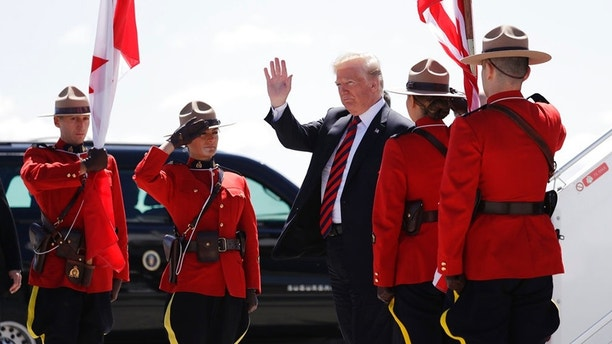 President Donald Trump arrives for the G7 Summit, Friday, June 8, 2018, in Canadian Forces Base Bagotville, Canada. (AP Photo/Evan Vucci)