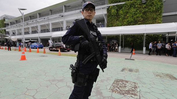 A police officer guards the entrance of the international media center Sunday, June 10, 2018, in Singapore ahead of the summit between U.S. President Donald Trump and North Korean leader Kim Jong Un on June 12. (AP Photo/Wong Maye-E)