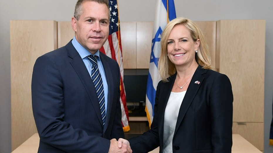Homeland Security Secretary Kirstjen Nielsen shakes hands with Israeli Minister of Public Security and Strategic Affairs Gilad Erdan at the U.S. Embassy in Jerusalem Monday.