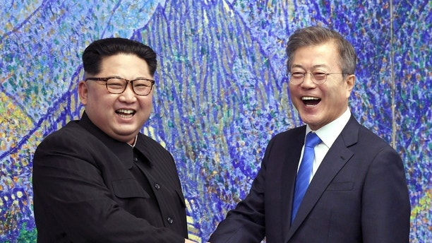 FILE - In this April 27, 2018, file photo, North Korean leader Kim Jong Un, left, poses with South Korean President Moon Jae-in for a photo inside the Peace House at the border village of Panmunjom in Demilitarized Zone, South Korea. The leaders announce aspirational goals of a nuclear-free peninsula and permanent peace. (Korea Summit Press Pool via AP. Pool, File)