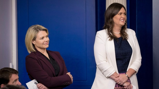 State Department spokeswoman Heather Nauert, left, and White House press secretary Sarah Huckabee Sanders, right, smile as Secretary of State Mike Pompeo speaks at a news conference on North Korea in the briefing room at the White House, Thursday, June 7, 2018, in Washington. (AP Photo/Andrew Harnik)