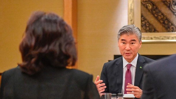 In this photo released by the U.S. State Department, U.S. Ambassador Sung Kim talks with members of the North Korean delegation during a working group meeting Monday, June 11, 2018 in Singapore one day before President Donald Trump will meet North Korean leader Kim Jong Un. (U.S. State Department via AP)