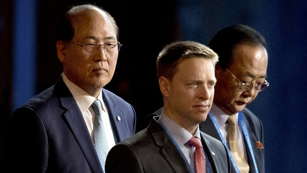 Matt Pottinger (C), Special Assistant to U.S. President Donald Trump and National Security Council (NSC) Senior Director for East Asia, and Kim Yong Jae (R), North KoreaÕs minister of external economic relations, arrive for the opening ceremony of the Belt and Road Forum at the China National Convention Center (CNCC) in Beijing, Sunday, May 14, 2017. AP Photo/Mark Schiefelbein/Pool - RC142C784F00