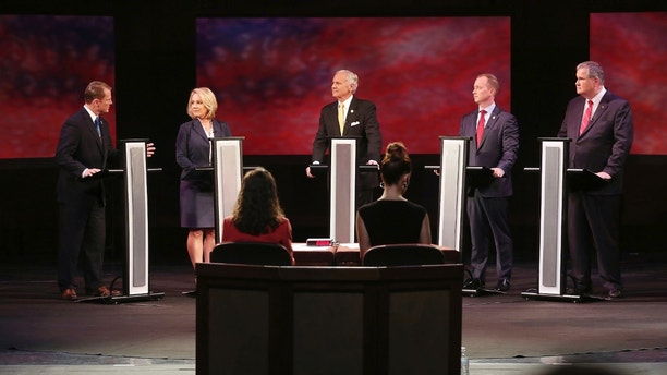 FILE - In this June 5, 2018 file photo, Republicans Lt. Gov. Kevin Bryant, from left, Catherine Templeton, Gov. Henry McMaster, John Warren and Yancey McGill participate in a gubernatorial primary debate at the University of South Carolina in Columbia, S.C.  The chief race among the challengers on Tuesday is to get to second place and have a two-week one-one-one sprint to a June 26 runoff.  (Grace Beahm Alford /The Post And Courier via AP, Pool)