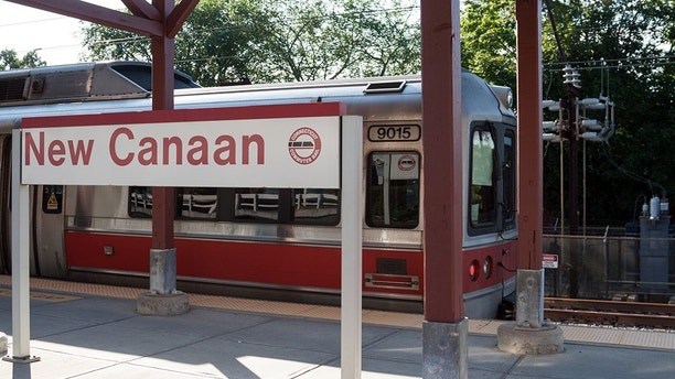 New Canaan, USA - July 22, 2012:Train station located in the downtown business area in the town of New Canaan. The town beginnings was with the establishment of the Canaan Parish and today the town is one the wealthiest communities in the country with a population of twenty thousand.