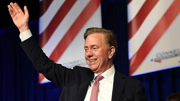 Ned Lamont waves after accepting the endorsement for governor by the Democrats at the State Democratic Convention, Saturday, May 19, 2018, in Hartford, Conn. Connecticut Democrats are gathering for a second consecutive day to finish endorsing their slate of candidates for the November elections, including governor. (AP Photo/Jessica Hill)