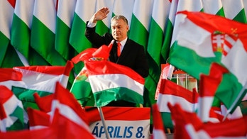 Prime Minister Viktor Orban's waves during the final electoral rally of his Fidesz party in Szekesfehervar, Hungary, Friday, April 6, 2018. Hungarians will vote Sunday in parliamentary elections, choosing 199 lawmakers and polls expect Prime Minister Viktor Orban to win a third consecutive term and his fourth overall since 1998.(AP Photo/Darko Vojinovic)