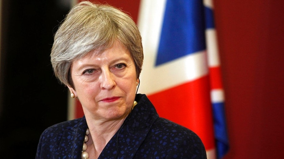 Prime Minister Theresa May faced a grilling at Parliament Wednesday over President Trump's migration policy.