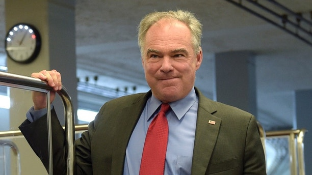 Sen. Tim Kaine, D-Va., gets off of the Senate subway as he heads to a luncheon with Democrats on Capitol Hill in Washington, Tuesday, Sept. 12, 2017. (AP Photo/Susan Walsh)