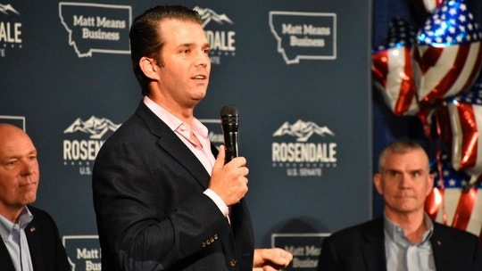 Donald Trump Jr., center, speaks to Montana Republicans at the state party's annual convention as U.S Rep. Greg Gianforte, left, and senate candidate Matt Rosendale, right, look on, at the Billings Hotel and Convention Center Friday, June 22, 2018, in Billings, Mont. Trump Jr. warned Republicans that Democrats are highly motivated heading into the November election. (AP Photo/Matthew Brown)