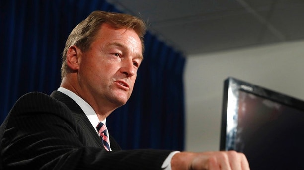 FILE - In this Oct. 4, 2017, file photo, Sen. Dean Heller, R-Nev, speaks during a media briefing at Metro Police headquarters in Las Vegas. President Donald Trump will headline the Nevada Republican Party's annual convention on Saturday, June 23, 2018, and also appear at a fundraiser with Heller, officials confirmed Monday, June 18. (Steve Marcus/Las Vegas Sun via AP, File)