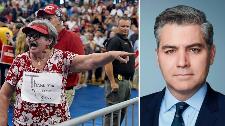 Maria Rojas, from West Columbia berates CNN Chief White House Correspondent Jim Acosta, right, before President Trump who is in town to support Gov. Henry McMaster speaks to the crowd at Airport High School Monday, June 25, 2018, in West Columbia, S.C.