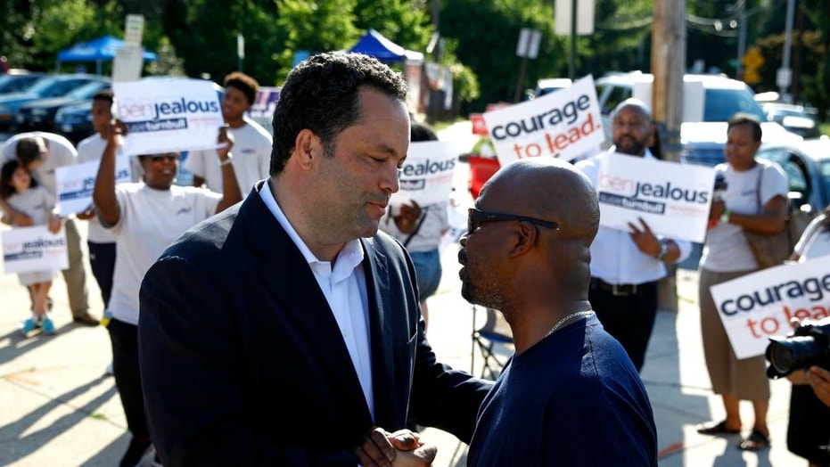 Maryland Democratic gubernatorial candidate Ben Jealous, left, speaks with Alvin Pierce as he greets voters outside a polling place in Baltimore, June 26, 2018.