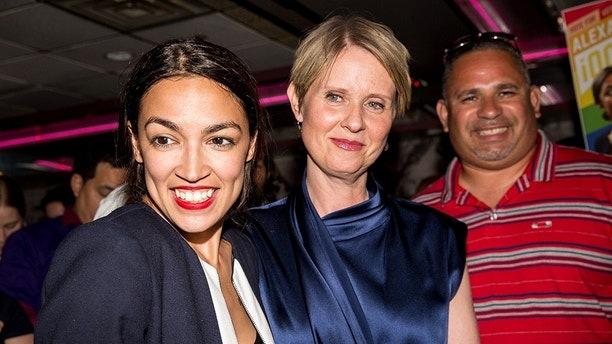 NEW YORK, NY - JUNE 26: Progressive challenger Alexandria Ocasio-Cortez is joined by New York gubenatorial candidate Cynthia Nixon at her victory party in the Bronx after upsetting incumbent Democratic Representative Joseph Crowly on June 26, 2018 in New York City. Ocasio-Cortez upset Rep. Joseph Crowley in New York's 14th Congressional District, which includes parts of the Bronx and Queens. (Photo by Scott Heins/Getty Images)