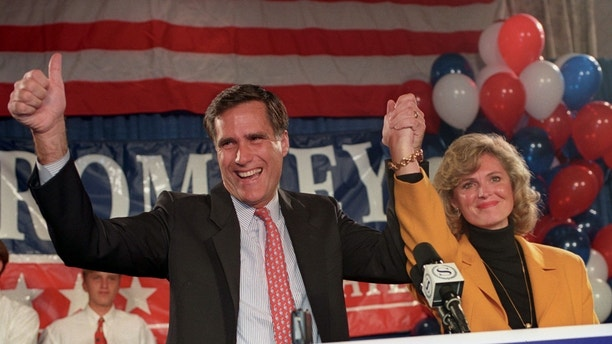 Mitt Romney and his wife Ann thank his supporters after he won the Republican primary on September 20, 1994 to go on to face Massachusetts senior Senator Ted Kennedy in the November election.  REUTERS/Brian Snyder - GF2DVGSAVHAB