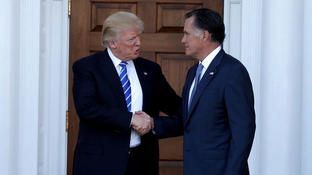 U.S. President-elect Donald Trump shakes hands with former Massachusetts Governor Mitt Romney after their meeting at the main clubhouse at Trump National Golf Club in Bedminster, New Jersey, U.S., November 19, 2016.  REUTERS/Mike Segar     TPX IMAGES OF THE DAY      - S1AEUNUCUTAA