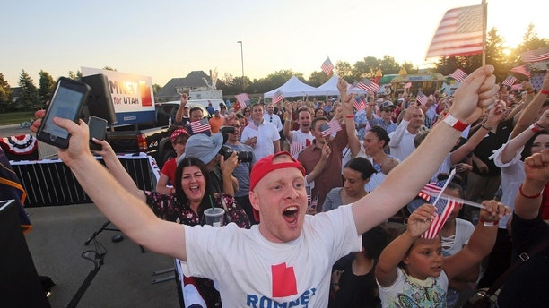 Mitt Romney supporters celebrate during a primary election night party, Tuesday, June 26, 2018, in Orem, Utah. Romney has won the Republican primary for a Utah Senate seat, setting him on the path to restart his political career with a Senate seat left open by retiring Sen. Orrin Hatch. (AP Photo/Rick Bowmer)