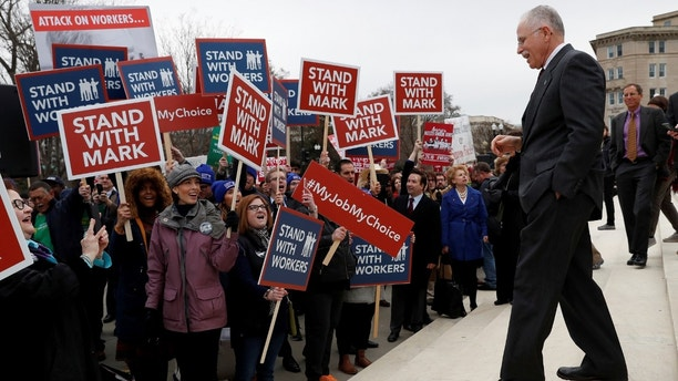 Mark Janus is cheered by supporters outside of the United States Supreme Court in Washington, U.S., February 26, 2018. REUTERS/Leah Millis - RC141D6C4090