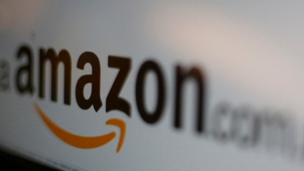 FILE PICTURE - The logo of the web service Amazon is pictured in this June 8, 2017 illustration photo. REUTERS/Carlos Jasso/Illustration/File Photo - RC1847D215A0
