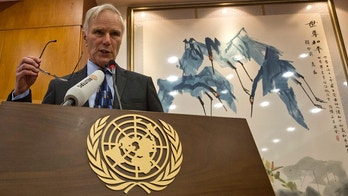 United Nations Special Rapporteur on extreme poverty and human rights, Philip Alston speaks during a press conference held in Beijing, China, Tuesday, Aug. 23, 2016. (AP Photo/Ng Han Guan)