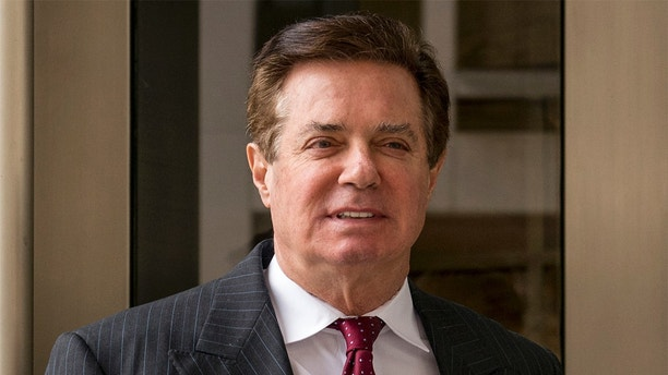 FILE - In this April 4, 2018, file photo, Paul Manafort, President Donald Trump's former campaign chairman, leaves the federal courthouse in Washington.  Manafort is appealing a judge's decision to jail him while he awaits trial on several felony charges. Attorneys for Paul Manafort filed a notice of appeal Monday saying they want a federal appeals court to review the order by U.S. District Judge Amy Berman Jackson. They also are appealing Jackson's order dismissing a civil suit Manafort brought challenging special counsel Robert Mueller's authority to prosecute him.  (AP Photo/Andrew Harnik, File)