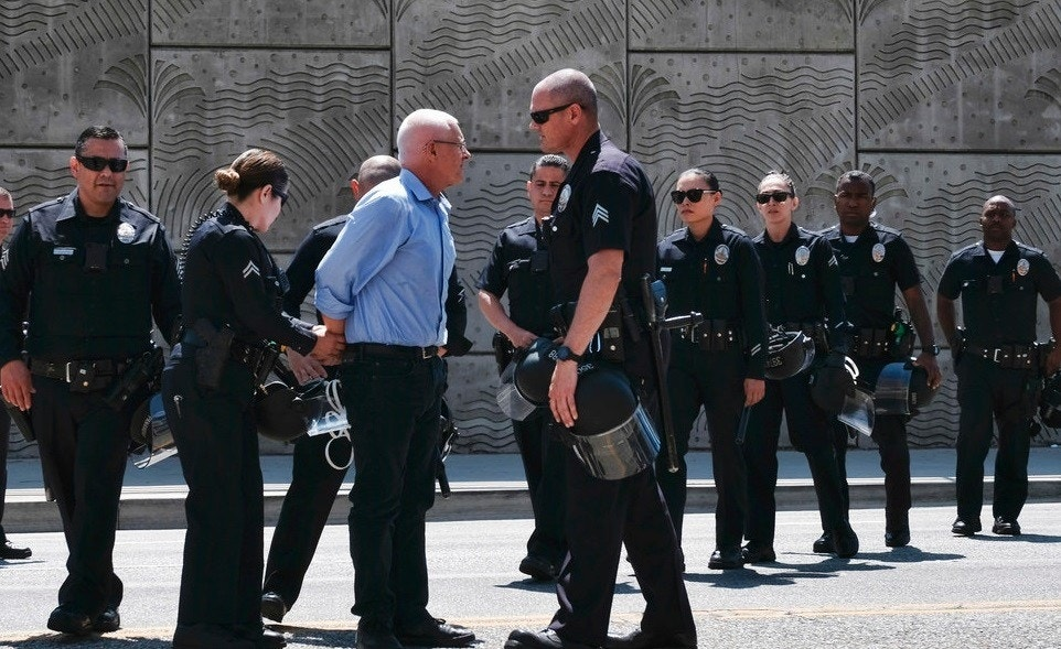 la city councilman mike bonin is arrested with 16 other protesters for blocking the entrance to the la metropolitan detention center