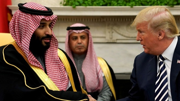 FILE PHOTO: U.S. President Donald Trump shakes hands with Saudi Arabia's Crown Prince Mohammed bin Salman in the Oval Office at the White House in Washington, U.S. March 20, 2018.  REUTERS/Jonathan Ernst/File Photo - RC15FBCC8C60