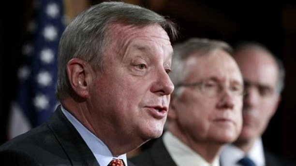FILE: Dec. 7, 2011: Sen. Dick Durbin, left, takes part in a news conference on Capitol Hill in Washington.