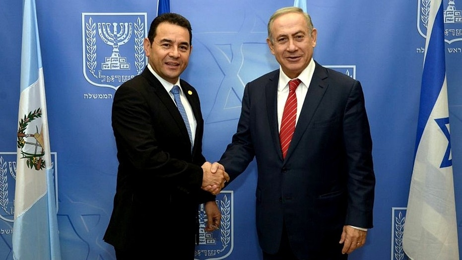 Guatemalan President Jimmy Morales and Israeli Prime Minister Benjamin Netanyahu shake hands at the opening of the Central American nation's embassy in Jerusalem.
