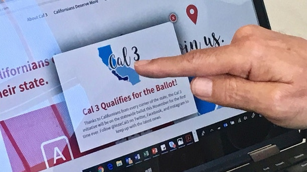 In this June 18, 2018, photo, venture capitalist Tim Draper points to a computer screen at his offices in San Mateo, Calif., showing that an initiative to split California into three states qualified for the ballot. Opponents of an initiative are asking the state Supreme Court to pull the measure from the ballot.  (AP Photo/Haven Daley)