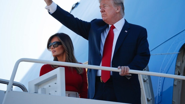 President Donald Trump and first lady Melania Trump board Air Force One, Tuesday, July 10, 2018, at Andrew Air Force Base, Md. Trump is traveling on a weeklong trip to Europe on a four-nation tour, with stops in Belgium, England, Scotland and Finland. (AP Photo/Pablo Martinez Monsivais)