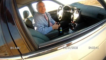 This image made from a March 27, 2018, law enforcement body camera video from the La Paz County Sheriff's Office, via KLPZ / ParkerLiveOnline, shows Arizona state Rep. Paul Mosley during a traffic stop outside Parker, Ariz. Mosley was seen telling a sheriff's deputy he sometimes drives as fast as 130 or 140 mph (210 or 225 kph) after he was pulled over for speeding, and the deputy said in a report later that the driver claimed to have legislative immunity (La Paz County Sheriff's Office/KLPZ/ParkerLiveOnline via AP)