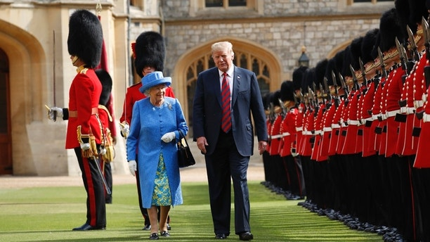 U.S. President Donald Trump with Queen Elizabeth II, inspects the Guard of Honour at Windsor Castle in Windsor, England. (AP Photo/Pablo Martinez Monsivais)