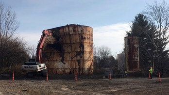 In this Dec. 11, 2017, photo, a tank at a Kiel Bros. facility is torn down in Indianapolis. The collapse of Kiel Bros. Oil Co. in 2004 was widely publicized. Less known is that the state of Indiana and, to a smaller extent, Kentucky and Illinois, are still on the hook for millions of dollars to clean up more than 85 contaminated sites across the three states, including underground tanks that leaked toxic chemicals into soil, streams and wells. (AP Photo/Brian Slodysko)