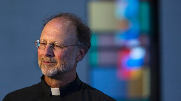 Father Fred Thelen speaks inside Cristo Rey Parish, in Lansing, Mich., Monday, July 16, 2018. Church officials say they will offer sanctuary to immigrants. (Cory Morse/The Grand Rapids Press-MLive.com via AP)