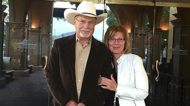 "In this 2017 photo provided by Bobby Wilson, Bobby Wilson and his wife, Eileen Pein Wilson, stand outside Casino del Sol near Tucson, Ariz. Wilson, a Republican Arizona state Senate candidate, has shocked gun control advocates by sharing details about shooting and killing his mother in apparent self-defense more than 50 years ago. Wilson, who is running to represent a southern Arizona district, told The Associated Press that he's not trying to hide anything. He says his mother was ""insane"" and shot at him with a rifle when he was in bed in their Oklahoma farmhouse one night in 1963. He then shot and killed her. Wilson's sister also died that night, and the house caught on fire. (Bobby Wilson via AP)"