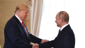 U.S. President Donald Trump and Russian President Vladimir Putin, right, welcome each other at the Presidential Palace in Helsinki, Finland, Monday, July 16, 2018 prior to Trump's and Putin's one-on-one meeting in the Finnish capital. (Alexei Nikolsky, Sputnik, Kremlin Pool Photo via AP)