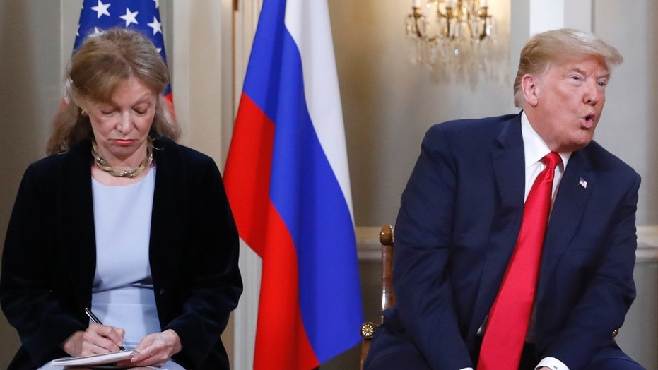 July 16: Interpreter Marina Gross takes notes while President Trump talks to Russian President Vladimir Putin.