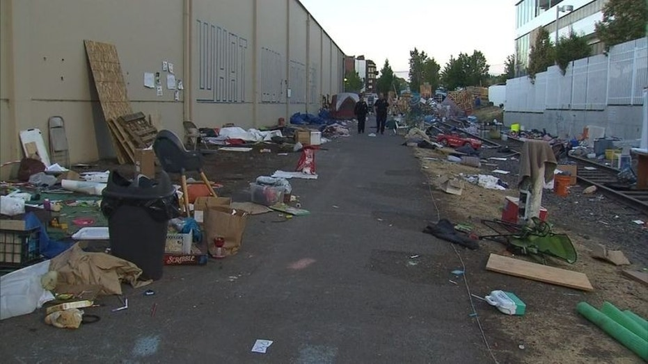 """Piles of debris awaited cleanup at an """"Occupy ICE"""" camp in Portland, Ore., after police cleared out protesters earlier this week."""