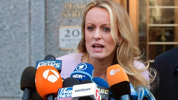 """FILE - In this April 16, 2018, file photo, adult film actress Stormy Daniels speaks outside federal court in New York. Daniels says her ex-lawyer was a """"puppet"""" for President Donald Trump and worked with the president's attorney to get her to appear on Fox News and falsely deny having sex with Trump. The allegations are made in a lawsuit filed June 6 in Los Angeles. The lawsuit alleges Trump's lawyer Michael Cohen """"colluded"""" with Daniels' then-attorney Keith Davidson to have her deny the relationship on Fox News after a tabloid magazine story about Daniels and Trump. (AP Photo/Mary Altaffer, file)"""
