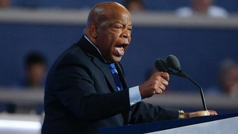 Rep. John Lewis (D-GA.) gestures as he nominates Hillary Clinton at the Democratic National Convention in Philadelphia, Pennsylvania, U.S. July 26, 2016. REUTERS/Lucy Nicholson - HT1EC7Q1NOY95