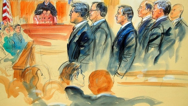 This courtroom sketch depicts Paul Manafort, fourth from right, standing with his lawyers in front of U.S. district Judge T.S. Ellis III, center rear, and the selected jury, seated left, during the jury selection of his trial at the Alexandria Federal Courthouse in Alexandria, Va., Tuesday, July 31, 2018. A jury set to decide the fate of President Donald Trump's former campaign chairman Manafort was selected Tuesday, and opening statements in his tax evasion and bank fraud trial were expected in the afternoon. (Dana Verkouteren via AP)