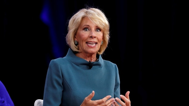 Education Secretary Betsy DeVos speaks at the Conservative Political Action Conference (CPAC) at National Harbor, Maryland,  U.S., February 22, 2018.  REUTERS/Kevin Lamarque - RC15A1D59C30