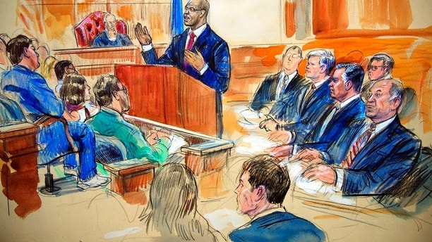 This courtroom sketch depicts Paul Manafort, seated right row second from right, together with his lawyers, the jury, seated left, and the U.S. District Court Judge T.S. Ellis III, back center, listening to Assistant U.S. Attorney Uzo Asonye, standing, during opening arguments in the trial of President Donald Trump's former campaign chairman Manafort's on tax evasion and bank fraud charges. (Dana Verkouteren via AP)