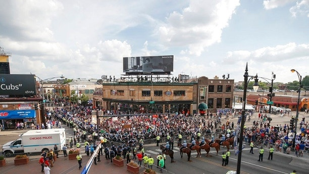 Protesters arrive at Wrigley Field to demand more government action against gun violence, Thursday, Aug. 2, 2018, in Chicago. (AP Photo/Kamil Krzaczynski)