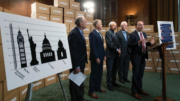From left, Senate Judiciary Chairman Chuck Grassley, R-Iowa, Sen. Thom Tillis, R-N.C., Sen. Orrin Hatch, R-Utah, Sen. John Cornyn, R-Texas, and Sen. Mike Lee, R-Utah, hold a news conference to refute Senate Democrats who are intensifying their fight over documents related to Supreme Court nominee Brett Kavanaugh's stint as staff secretary at the White House, on Capitol Hill in Washington, Thursday, Aug. 2, 2018. The GOP members of the Judiciary Committee used a wall of empty boxes to dramatize the amount of documents. (AP Photo/J. Scott Applewhite)