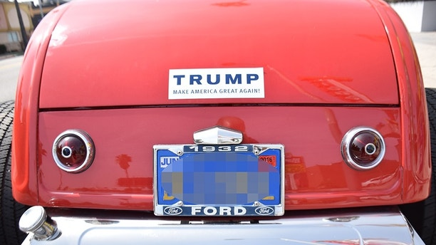 A Trump supporter wrote a slogan on his tuned car to support the leader in the Republican race for the presidential nomination Donald Trump in Los Angeles, CA, USA, on March 20, 2016. Photo by JMP/Sipa USA